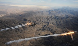 A two ship of B-1B Lancers assigned to the 28th Bomb Squadron, Dyess Air Force Base, Texas, release chaff and flares while maneuvering over New Mexico during a training mission on Feb. 24, 2010. Dyess will celebrate the 25th anniversary of the first B-1B bomber arriving at the base with the Dyess Big Country Airfest and Open House on May 1, 2010. (U.S. Air Force photo/ Master Sgt. Kevin J. Gruenwald) released