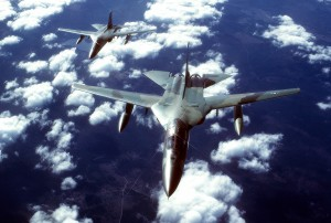 An air-to-air front overhead view of two FB-111 aircraft in formation.