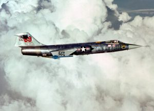 An air-to-air right side view of an F-104 Starfighter aircraft carrying two AIM-9J Sidewinder missiles. The aircraft, from the 69th Tactical Fighter Training Squadron, 58th Tactical Training Wing, 12th Air Force, is involved in Tactical Training Luke.